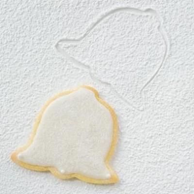 Festive icing-enrobed allspice biscuit bells