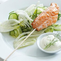Fish on a stick with shaved fennel and cucumber salad