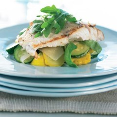 Fish steaks with parmesan and assorted summer squash