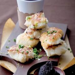 Fluffy potato cakes with black caviar