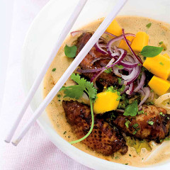 Fragrant coconut and sticky chicken wing curry with sweet  mango and noodles
