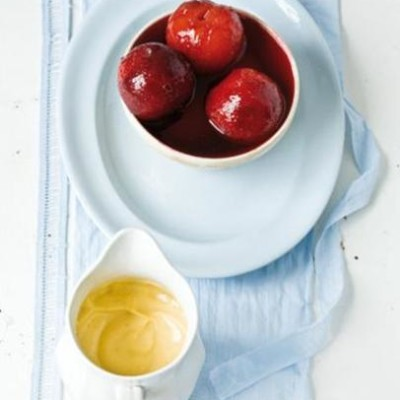 Fragrant plums poached in Cinzano and served with vanilla and nutmeg custard