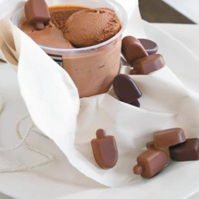 Frozen classic chocolate mousse with little chocolate lollies ...