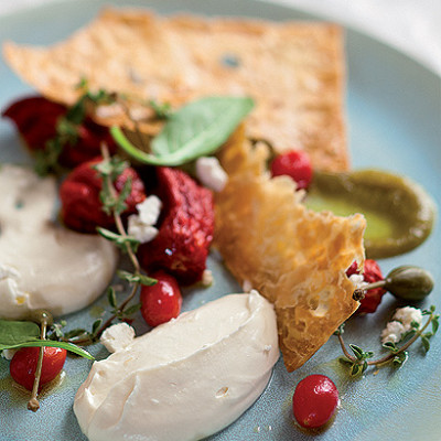 Goats-cheese mousse with semi-dried and pickled tomatoes