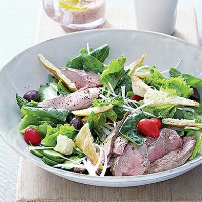 Grilled lamb and feta salad with sumac dressing and pitta croutons