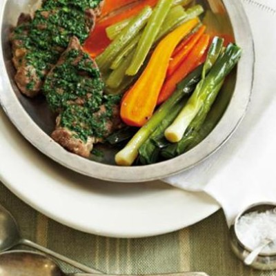 Grilled lamb steaks with braised vegetables
