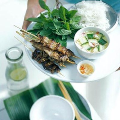 Grilled lemon grass beef skewers with lettuce, herbs and dips ...
