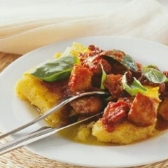 Grilled polenta with calamari in thick tomato wine sauce