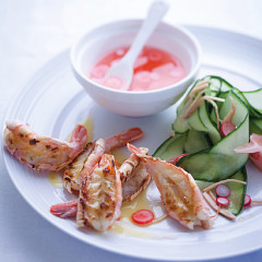 Grilled prawns in lime butter with pickled radish and cucumber salad