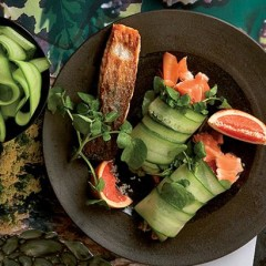 Grilled salmon wrapped in cucumber salad