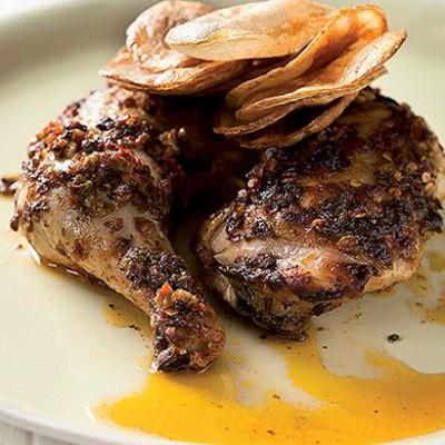 Harissa charred chicken with potato sheets