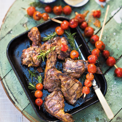 Harissa lamb chops with blistered tomatoes on skewers