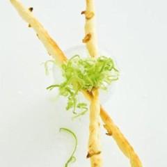 Homemade roasted garlic breadsticks with curly celery salt
