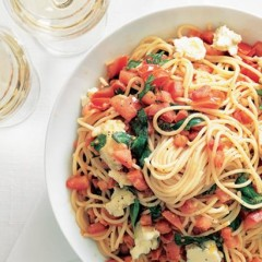 Hot pasta with cold tomato, anchovy and basil sauce