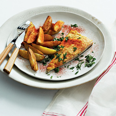 Hummus-topped angel fish with cayenne-dusted potato wedges