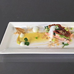 Jasmine oil-poached salmon with pea puree, pickled cucumber, crisp prosciutto and passion fruit sauce