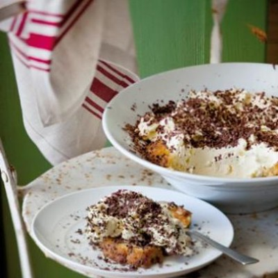 Kahlua-drenched tiramisu with mascarpone topped with delicate chocolate shavings