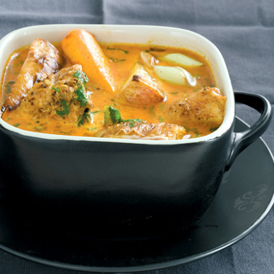 Korma-spiced Indian curry with roast chicken and chunky vegetables