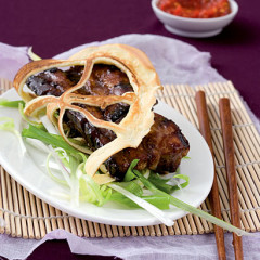 Lace pancakes stuffed with sticky soy ribs served with spring-onion curls