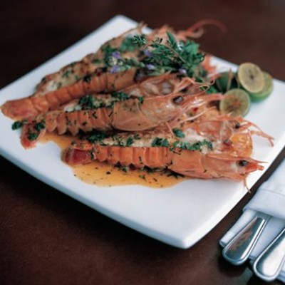 Langoustines in a spicy lemon butter sauce with rocket and parmesan salad