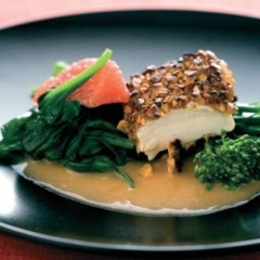 Macadamia nut-crusted tofu with greens and grapefruit cream