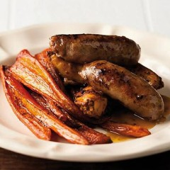 Maple syrup-roasted carrots and chilli potato wedges with pork bangers