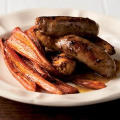 Maple syrup-roasted carrots and chilli wedges with pork bangers