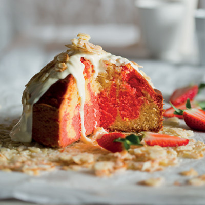 Marbled sponge cake with white chocolate ganache and rosewater candied almonds
