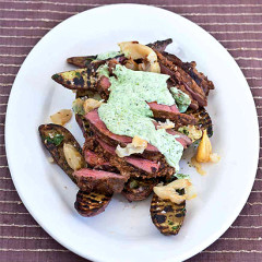 Marinated butterflied leg of lamb with sweet potatoes and garlic-coriander pesto