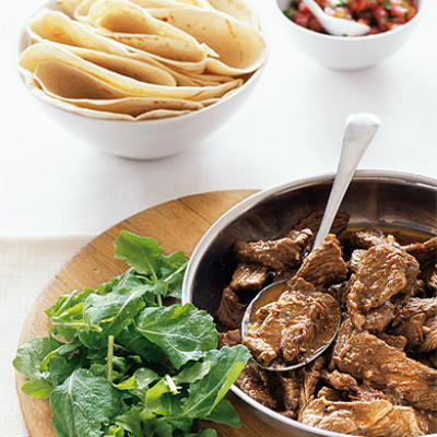 Mexican spiced beef strips with tortillas and salsa