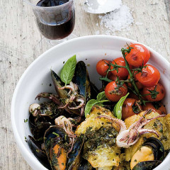 Mussels and squid in fresh-basil pesto with burst vine tomatoes