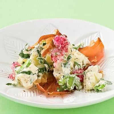 New-style creamy summer potato salad with baked serrano wafers and radish shavings