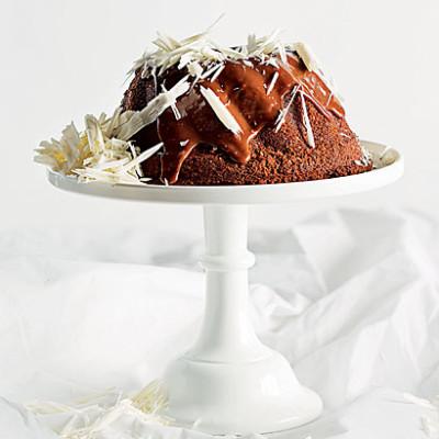 Nutty Wheat, sweet potato, orange and dark chocolate bundt cake with milk chocolate ganache and white chocolate shavings