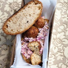 Open chicken croquette and coleslaw sandwich
