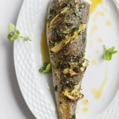 Oven-roasted hake stuffed with fresh herbs and zesty lemon