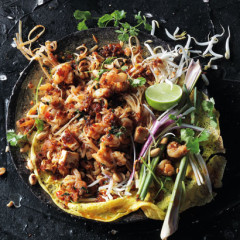 Pad Thai garnished with lemongrass, lime, coriander and spring onions