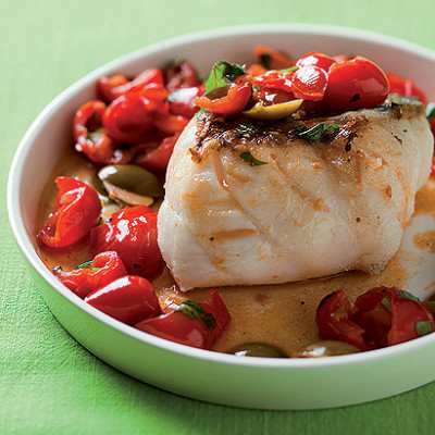 Pan-roasted fish with smashed tomatoes and green olives