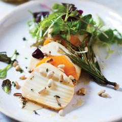 Persimmon and smoked mozzarella salad with pine nuts and pine-needle honey