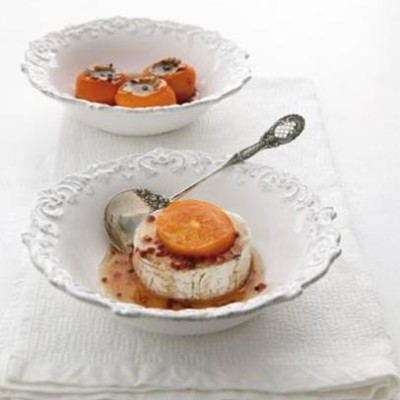 Persimmons poached in dessert wine and pink pepper