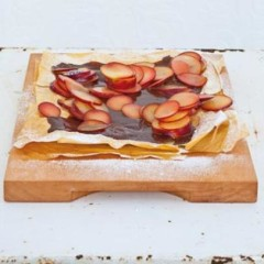 Phyllo pastry sheets smothered in rich chocolate ganache and topped with plum slivers