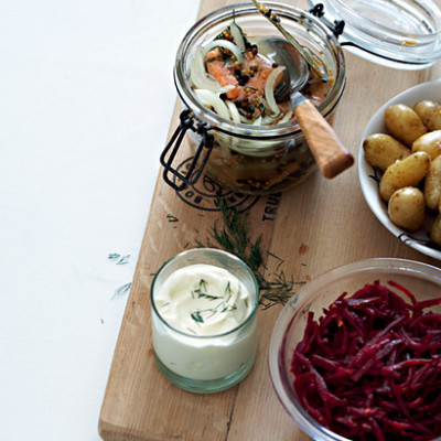 Pickled salmon trout with baby potatoes and hot beetroot salad