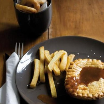 Pie and chips with traditional gravy and crispy onion rings