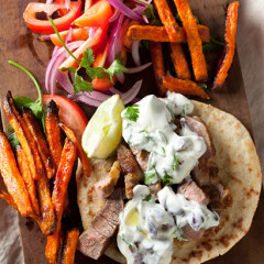 Pita with lamb steaks, yoghurt and sweet potato chips