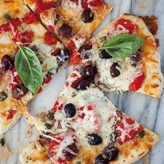 Pizza with mozzarella, olives, anchovies and capers