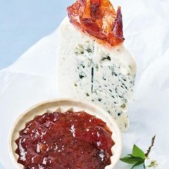 Plum paste served with a wedge of creamy gorgonzola