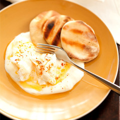 Poached eggs with yoghurt, saffron and smoked paprika sauce