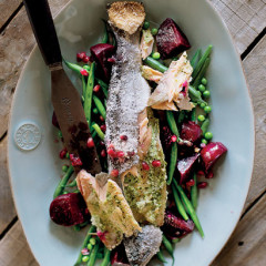 Pomegranate salt-roasted trout with balsamic beetroot and greens