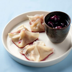 Pork and ginger wontons with cherry dipping sauce