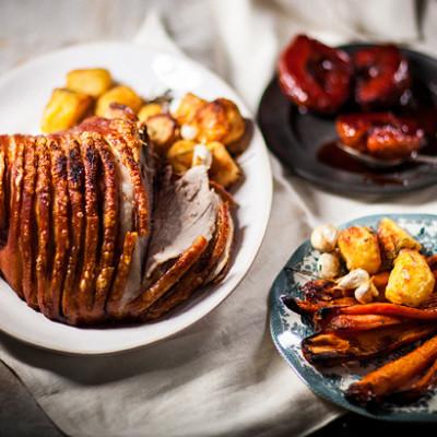 Pork leg roast with rosemary roast potatoes and crimson quinces