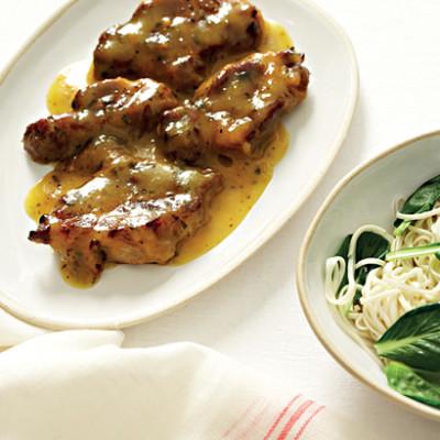 Pork neck steaks with clementine sauce